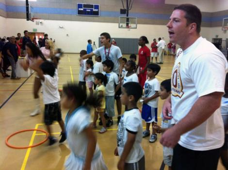 Redskins player Nick Sundberg coaches the kids on his hula hoop relay team during the Redskins' 80th anniversary event at the Montgomery County Recreation Center July 24.