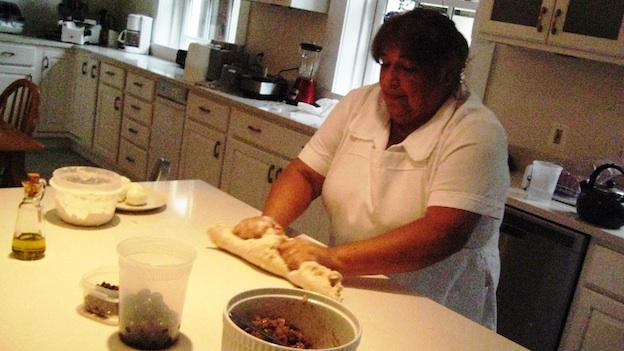 Maria Rosario Gomez cooks authentic, classic Chilean dishes at the Chilean Embassy residence in Washington, D.C. Here, she's rolling out masa, or dough, for empanadas.