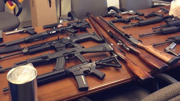 Firearms and ammunition recovered from the home of a Crofton, Md. man who threatened a shooting at his workplace, federal mailing contractor Pitney Bowes.