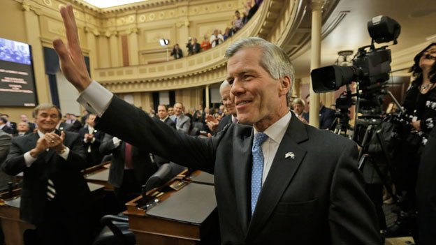 Virginia Gov. Bob McDonnell waves to the crowd after delivering his final State of the Commonwealth address before a joint session of the 2014 General Assembly at the Capitol in Richmond, Va., Wednesday, Jan. 8, 2014.