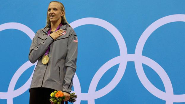 United States' Dana Vollmer poses with her gold medal for the women's 100-meter butterfly swimming final at the Aquatics Centre in the Olympic Park in London.