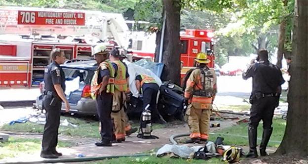 Police and firefighters were on the scene of a fatal accident in Chevy Chase, Md., where a car swerved head-on into a tree.