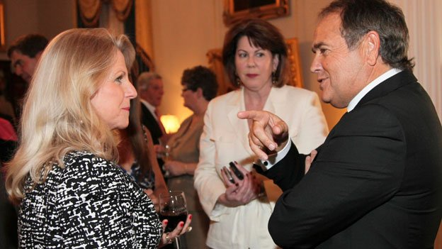 This May 5, 2011 photo provided by the office of the Governor of Virginia shows Jonnie Williams, right, and Virginia first lady Maureen McDonnell, left, during a reception for the NASCAR race at the Executive Mansion in Richmond, Va. Former executive assistant for Mrs. McDonnell, Mary Shea Sutherland, center, listens to the conversation.