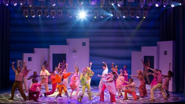 The North American touring cast of Mamma Mia! performs one of the show's hit tunes.