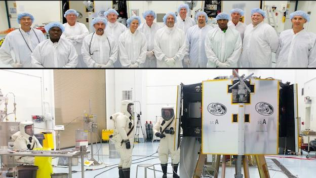 Workers at Cape Kennedy fill the RBSP spacecraft with propellant. Though the mission will last just two years, because the spacecraft will be constantly spinning, they'll be loaded with enough propellant for four years.