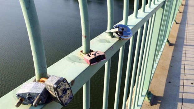 Love locks on Key Bridge are still relatively sparse compared to counterparts in Europe or even New York City.
