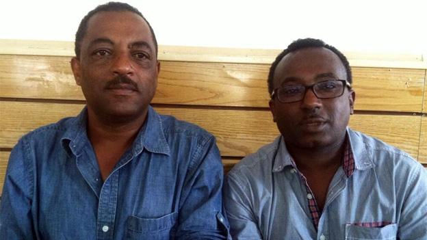 Taxi drivers Aleme Tadesse, left, and Addis Aemero, right, are collecting signatures to try and push back the deadline to install credit card machines.