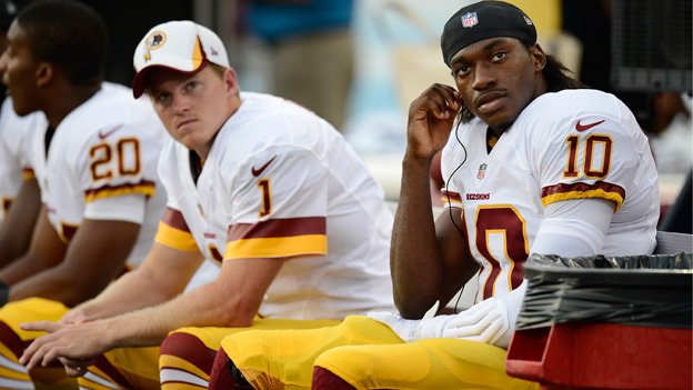 Washington Redskins quarterback Robert Griffin III (10) and kicker John Potter (1) watch from the bench in a preseason game earlier this year.