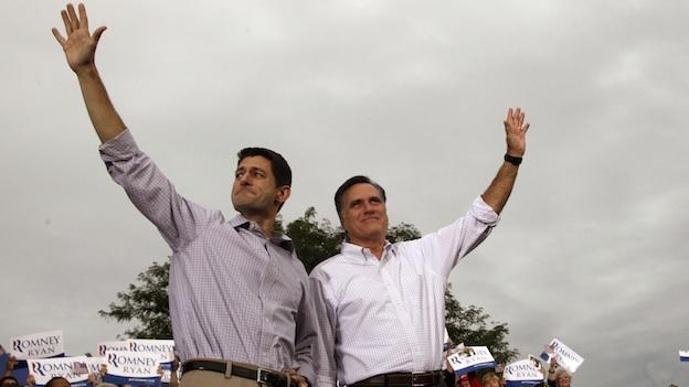 Republican presidential candidate, former Massachusetts Gov. Mitt Romney, right, and vice presidential running mate Rep. Paul Ryan of Wisconsin, greet the crowd during a campaign event at the Waukesha County Expo Center, Sunday, Aug. 12, 2012.