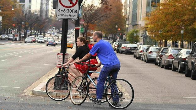 Two bicyclists cross the street in Northwest Washington, D.C.