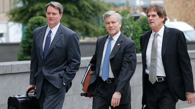 Former Virginia Gov. Bob McDonnell, center, arrives at federal court with his attorneys, John Brownlee, left, and Henry Asbill, right, in Richmond, Va., Monday, Aug. 18, 2014. McDonnell presents his defense in his corruption trial today.
