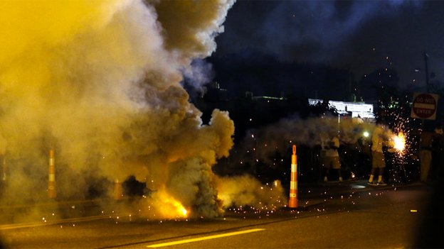 Teargas is deployed after police were fired upon Monday in Ferguson, Mo.