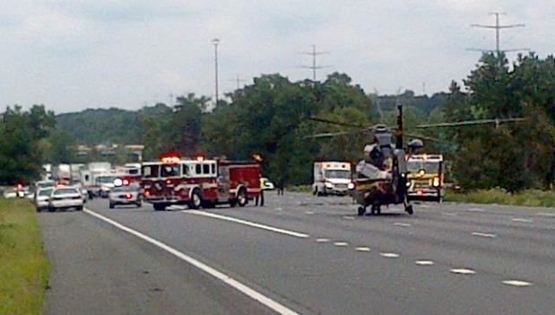 A fire truck and helicopter were on the scene of an accident involving a police cruiser on I-95 in Prince George's County.