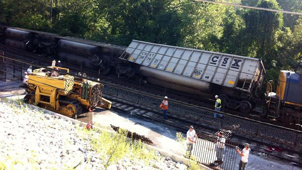 Overturned cars after a CSX train derailed in Ellicott City, Md. early in the morning Aug. 21.