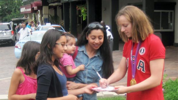 Olympic swimmer Katie Ledecky, right, signs autographs for her Bethesda admirers.