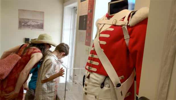A family looks at one of the many exhibits at the Battle of Bladensburg Visitors Center in Prince George's County.
