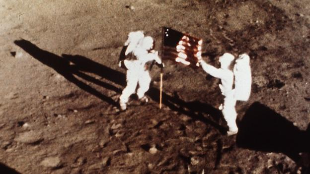"In this July 20, 1969 file photo provided by NASA shows Apollo 11 astronauts Neil Armstrong and Edwin E. ""Buzz"" Aldrin, the first men to land on the moon, plant the U.S. flag on the lunar surface."