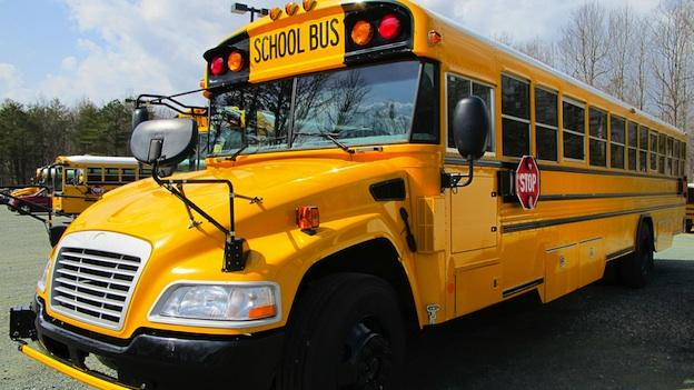 Drivers who roll past stopped schools buses in Montgomery County that are picking up children will face a $250 fine.