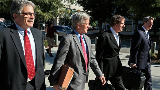 Former Virginia Gov. Bob McDonnell, second from left, arrives at federal court with his attorneys Danial Small, left, Henry Asbill second from right, and John Brownlee, right, Wednesday, Aug. 27, 2014, in Richmond, Va.