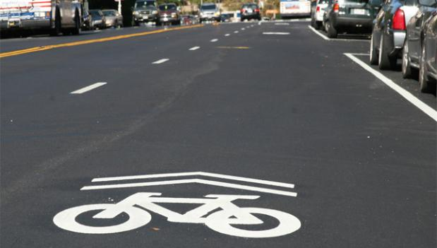 Some bike lanes in Arlington will be receiving a coat of green paint to make them more visible to drivers.