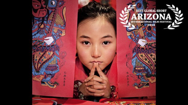 Door God, a narrative short, centers on a 7-year-old girl named Lingli who has has been waiting two years for her mother to come home.