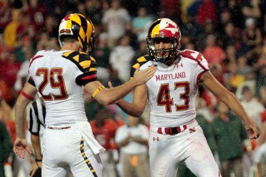 Holder Michael Tart #29 celebrates a late fourth quarter field goal with  kicker Nick Ferrara #43 of the Maryland Terrapins against the Miami  Hurricanes.