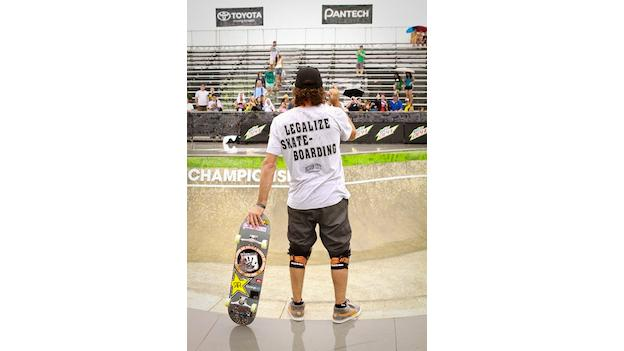 "Baltimore native Bucky Lasek wears a t-shirt that says ""Legalize Skateboarding."""