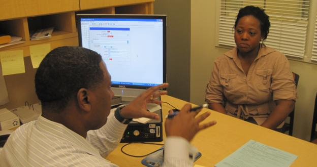 Brandene Leys talks with her adviser at PGCC, who specializes in helping veterans.