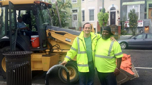 DC Water's George Hawkins, left, with another crew member in Bloomingdale Saturday. The agency was prepared to respond with sandbags and backhose in case of flash flooding during Saturday's storms.