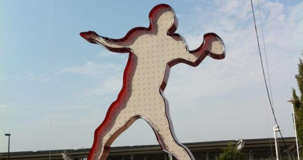 A giant football player made of Redskins burgundy solar panels now graces the parking lot at FedEx Field.