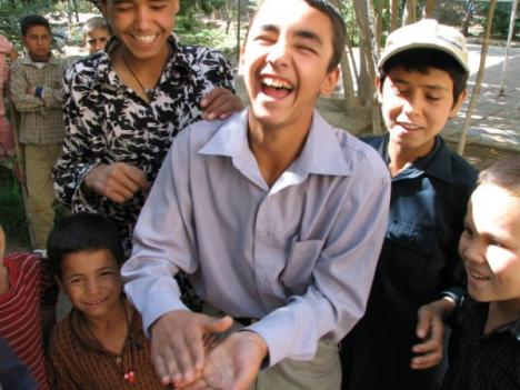 Children's circus participants laugh at a magic trick in Kabul Afghanistan