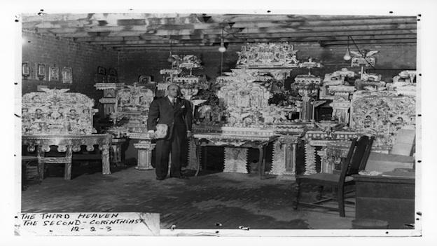"""James Hampton with his """"Throne of the Third Heaven of the Nations' Millennium General Assembly,"""" late 1950's."""