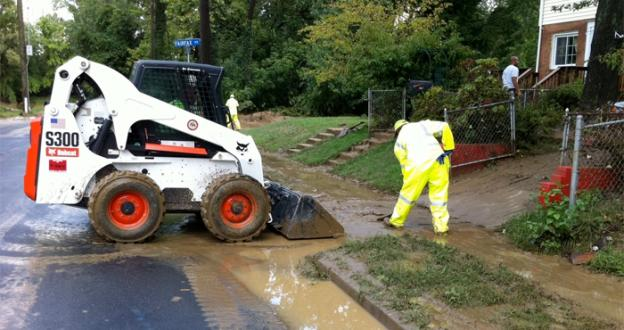 Workers in Hungington, Va. clean up after flooding once again inundated the region -- voters will soon be able to decide on whether Huntington should be equipped with a floodwall.