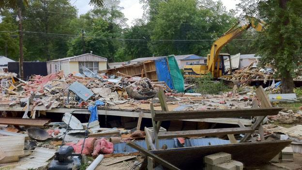 Most of a mobile home park in Woodbridge, Va. is being bulldozed after last week's heavy rains. The homes were condemned by Prince William County after severe flooding affected the park.