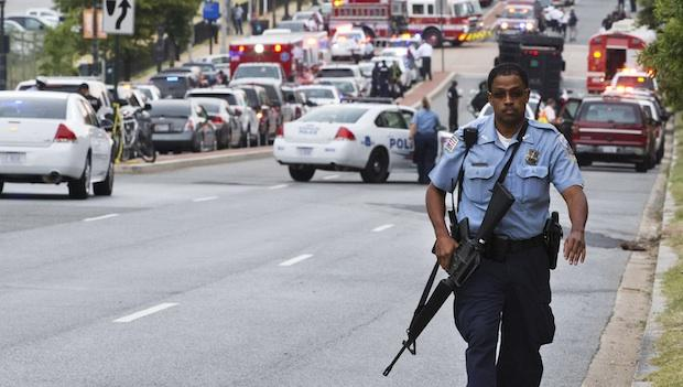 Police officers are questioning the armed response to Monday's shooting at the Washington Navy Yard.