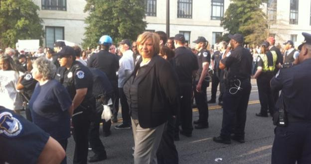 Council Mayor Yvette Alexander handcuffed at protest over the federal budget in April. Eight activists who were also arrested will stand trial in November.