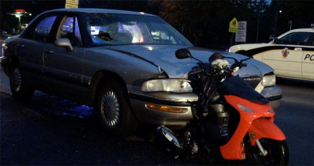 A man was killed Thursday morning when his scooter was struck from behind by a Buick Lacrosse.
