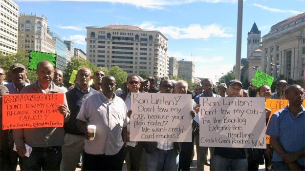 Nearly 200 cabbies took to Freedom Plaza Wednesday morning to protest the Oct. 1 deadline to install credit card machines.ww