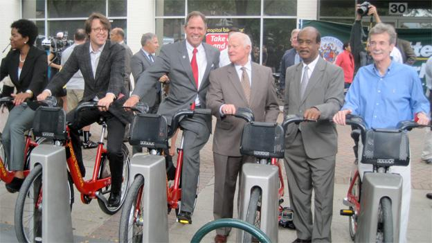 At the Rockville BikeShare station, from left to right, Councilwoman Valerie Ervin, Councilman Hans Riemer, Councilman Roger Berliner, Maryland Transportation Secretary Jim Smith, Montgomery County executive Isiah Leggett and Maryland State Senator Brian Frosh.