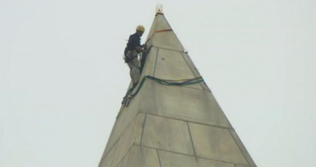 Workers rappelled down the outside of the Washington Monument on Tuesday in order to assess the damage from the 5.8-magnitude earthquake in August.
