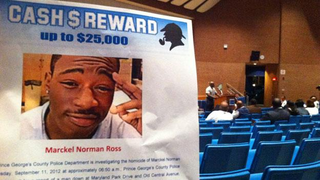 A flier seeking information on the killing of Marckel Ross posted at a community meeting hosted by Prince George's County police.