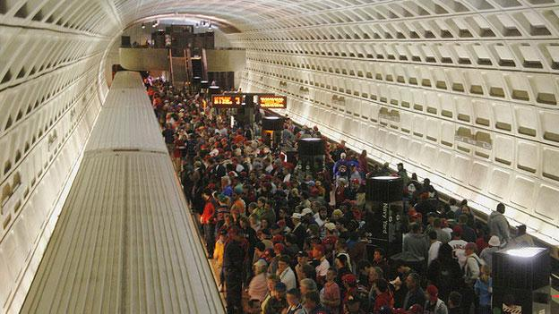 Fans fill the Navy Yard-Ballpark Metro station after a Nationals game. That Nationals have been wrangling with Metro and D.C. over who will pay for late-night Metro service after potential late-running playoff games.