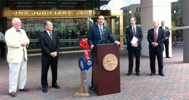 D.C. Leaders celebrate the completion of $7.5 million in energy upgrades at One Judiciary Square. The project also produced 119 jobs.