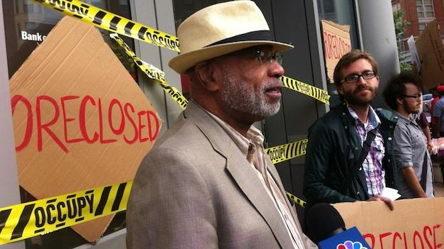 Rev. Robert Vanzant protests the foreclosure of his home outside the Bank of America on 14th Street NW in Columbia Heights.