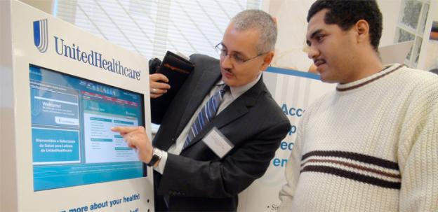 Dr. Jaime Gonzalez of United Healthcare shows how to use the new health kiosk.
