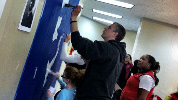 U.S. Education Secretary Arne Duncan paints a mural at Dunbar High School in D.C. during a day of service honoring Dr. Martin Luther King Jr.