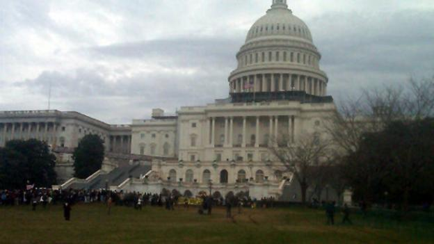 As Congress returns from its winter recess, protesters aligned with the Occupy Wall Street movement demonstrate on Capitol Hill in Washington, Tuesday, Jan. 17, to decry the influence of corporate money in politics.