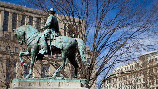 The statue of General McPherson looks down on the square named after him, which has served as a home to Occupy DC protesters for the past few months.