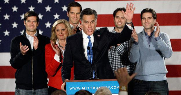 Republican presidential candidate and former Massachusetts Gov. Mitt Romney with his family in Iowa Jan. 3. Romney won the Iowa Republican caucus by just 8 votes.