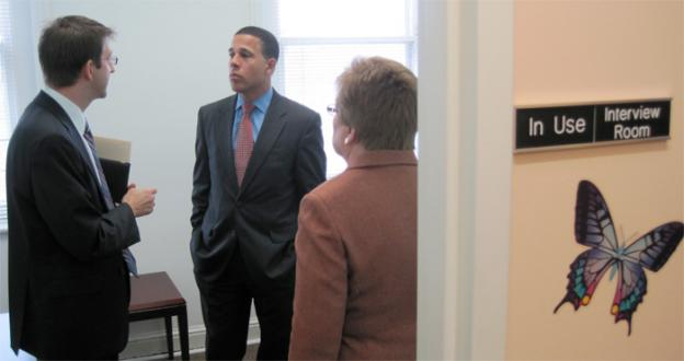 Maryland lieutenant governor Anthony Brown (center) receives tour of the Baltimore Child Abuse Center.  At left is the center's director Adam Rosenberg.